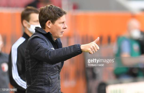 Wolfsburg's German head coach Oliver Glasner gives the thumbs-up during the German first division Bundesliga football match FC Augsburg v VfL...