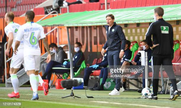 Wolfsburg's German head coach Oliver Glasner shouts instructions to his players during the German first division Bundesliga football match FC...