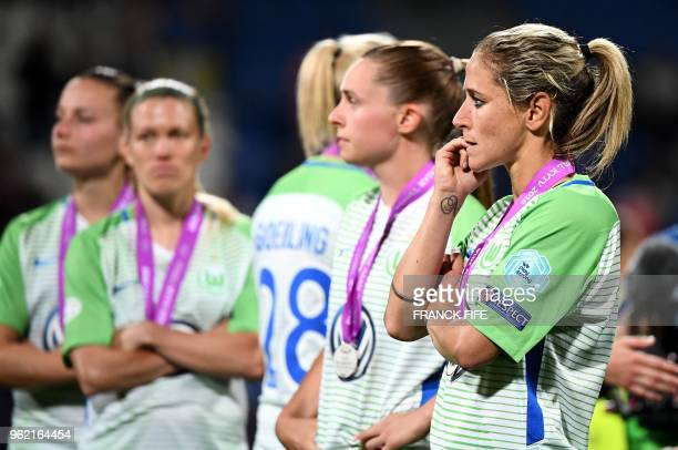 Wolfsburg's German midfielder Anna Blasse and teammates reacts after being defeated at the end of the UEFA Women's Champions League final football...
