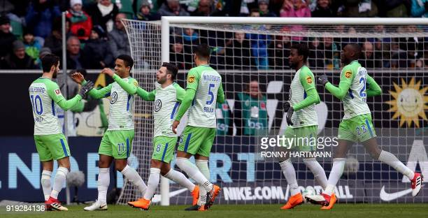 Wolfsburg's German midfielder Daniel Didavi celebrates with teammates after scoring the 10 during the German first division Bundesliga football match...