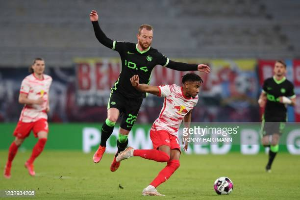 Wolfsburg's German midfielder Maximilian Arnold and Leipzig's French midfielder Christopher Nkunku vie for the ball during the German first division...