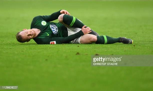 Wolfsburg's German midfielder Maximilian Arnold lies on the pitch during the German first division Bundesliga football match Bayern Munich vs VfL...