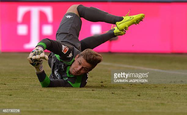 Wolfsburg's goalkeeper Patrick Drewes dives for the ball during the penalty shoot out during the Telekom Cup semifinal football match Hamburg SV vs...