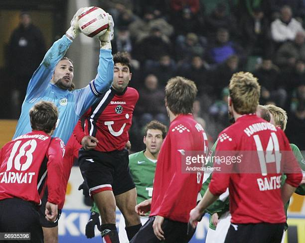 Wolfsburg's goalkeeper Simon Jentzsch saves the ball as Michael Tarnat, Vahid Hashemian, Christoph Dabrowski and Hanno Balitsch of Hanover look on...