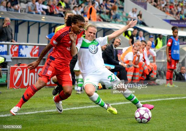 Wolfsburg's Isabel Kerschowski and Lyon's in action Élodie Thomis during the Womens Champions League soccer finale between VfL Wolfsburg and...