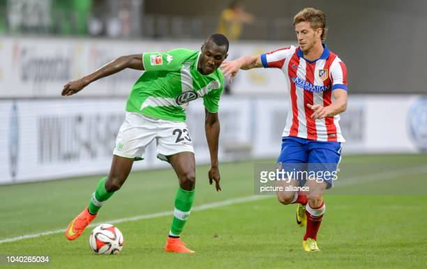 Wolfsburg's Josuha Guilavogui and Madrid's Cristian Ansaldi in action during the soccer test match between VfL Wolfsburg and Atletico Madrid at...