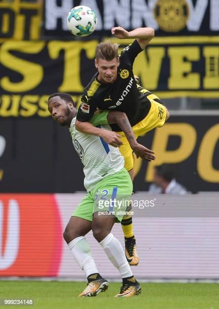 Wolfsburg's Kaylen Hinds and Dortmund's Lukasz Piszczek vie for the ball during the German Bundesliga soccer match between VfL Wolfsburg and Borussia...