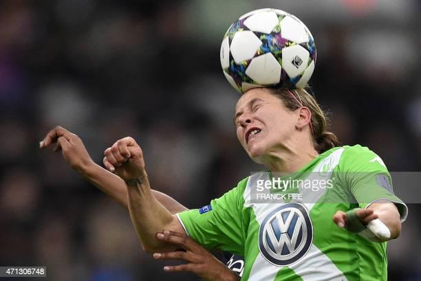 Wolfsburg's midfielder Anna Blasse heads the ball during the UEFA Women's Champions League semifinal second leg football match Paris SaintGermain vs...