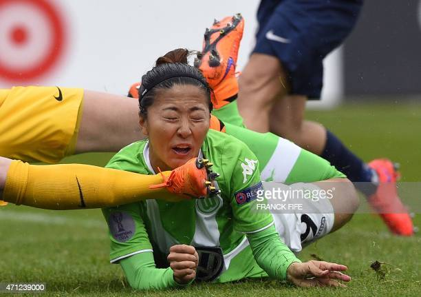 Wolfsburg's midfielder Anna Blasse vies with Paris SaintGermain's Polish goalkeeper Katarzyna Kiedrzynek during the UEFA Women's Champions League...