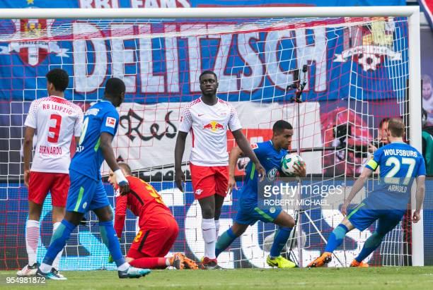 Wolfsburg´s midfielder Daniel Didavi grabs the ball after scoring during the German first division Bundesliga football match RB Leipzig vs VfL...