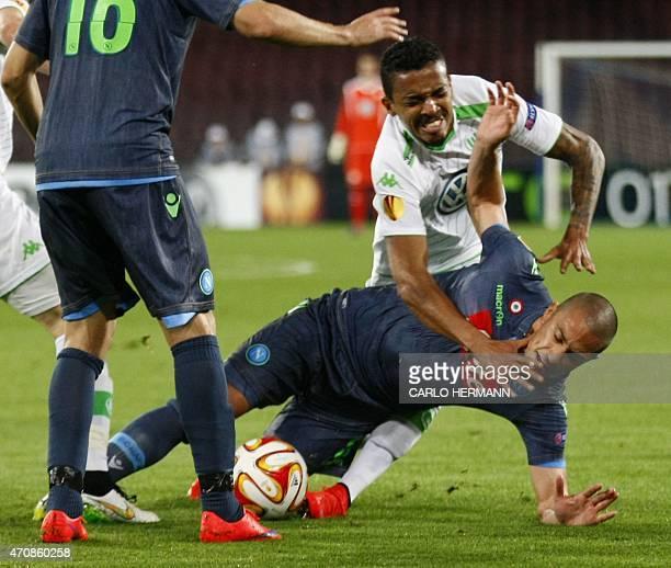 Wolfsburg's midfielder from Brazil Luiz Gustavo fights for the ball with Napoli's midfielder from Switzerland Gokhan Inler during the UEFA Europa...
