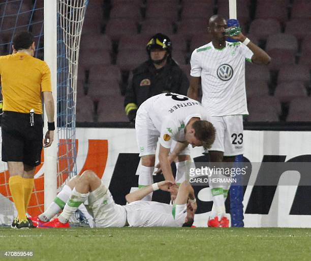 Wolfsburg's midfielder from Croatia Ivan Perisic lies on the ground after an injury during the UEFA Europa League quarter final second leg football...