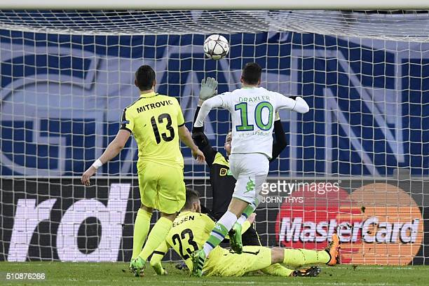 Wolfsburg's midfielder Julian Draxler scores a goal during the UEFA Champions League football match between Gent and Wolfsburg at Ghelamco Arena in...