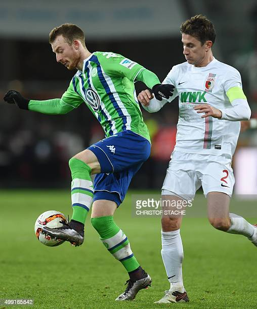 Wolfsburg's midfielder Maximilian Arnold and Augsburg's Dutch defender Paul Verhaegh vie for the ball during the German first division Bundesliga...