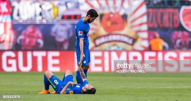 Wolfsburg´s midfielder Renato Steffen and Turkish midfielder Yunus Malli react after loosing the German first division Bundesliga football match RB...
