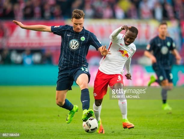 Wolfsburg's midfielder Yannick Gerhardt and Leipzig's Guinean midfielder Naby Deco Keita vie for the ball during the German First division Bundesliga...