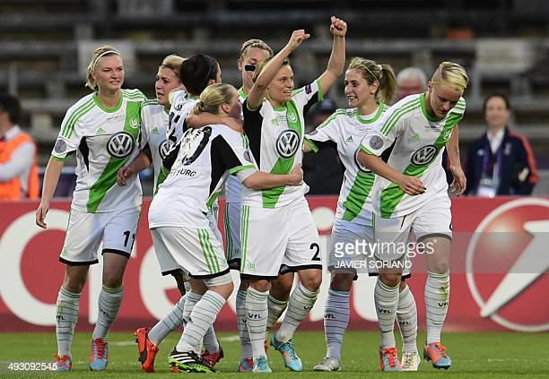 Wolfsburg's players celebrate their second goal during the UEFA Women's Champions League final football match Tyreso FF vs Vfl Wolfsburg at Restelo...