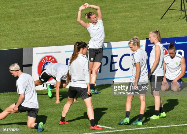 Wolfsburg's players stretch during a training session at the Valeriy Lobanovsky Stadium in Kiev on May 23 on the eve of the UEFA Women's Champions...