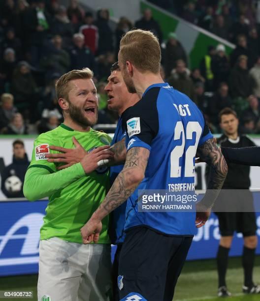 Wolfsburg's Polish midfielder Jakub Baszczykowski argues with Hoffenheim's Swiss midfielder Steven Zuber and Hoffenheim's midfielder Kevin Vogt...