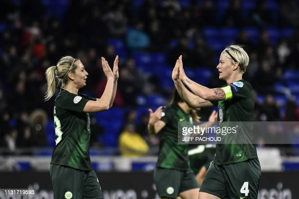 Wolfsburg's Swedish defender Nilla Fischer celebrates with a teammate after scoring during the UEFA women's Champions League quarterfinal football...