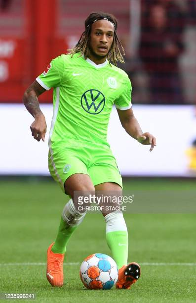Wolfsburg's Swiss defender Kevin Mbabu plays the ball during the German first division Bundesliga match between Union Berlin and VfL Wolfsburg in the...