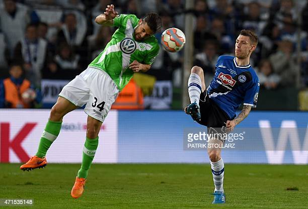 Wolfsburg's Swiss defender Ricardo Rodriguez and Bielefeld`s defender Florian Dick vie for the ball during the German Cup DFB Pokal semifinal...