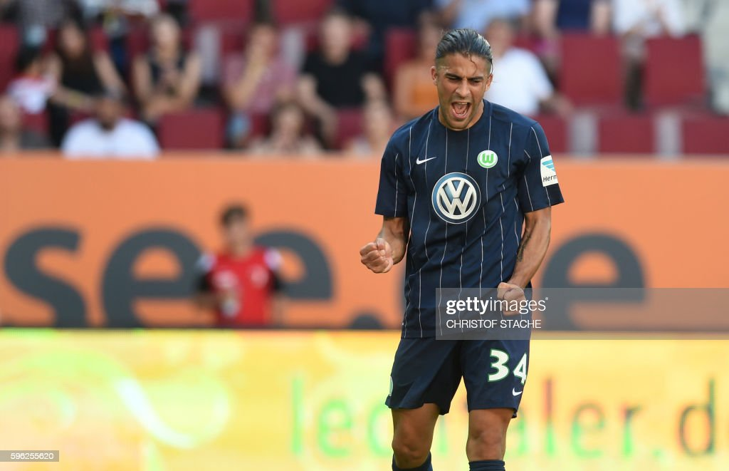 Wolfsburg's Swiss defender Ricardo Rodriguez celebrates after his goal for Wolfsburg during the German first division Bundesliga football match of FC Augsburg vs VfL Wolfsburg in Augsburg, southern Germany, on August 27, 2016. / AFP / CHRISTOF