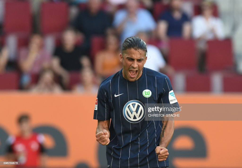Wolfsburg's Swiss defender Ricardo Rodriguez celebrates after his goal for Wolfsburg during the German first division Bundesliga football match of FC Augsburg vs VfL Wolfsburg in Augsburg, southern Germany, on August 27, 2016. /