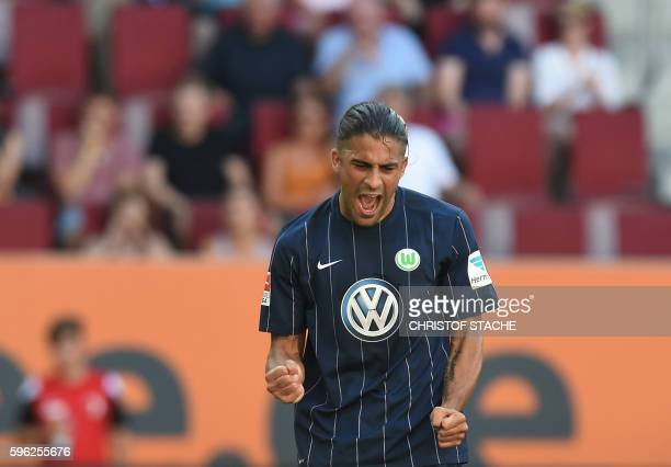 Wolfsburg's Swiss defender Ricardo Rodriguez celebrates after his goal for Wolfsburg during the German first division Bundesliga football match of FC...