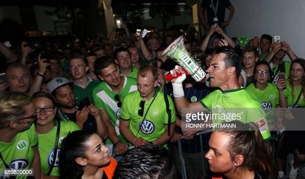 Wolfsburg's Swiss goalkeeper Diego Benaglio celebrates with supporters after German Bundesliga relegation second leg football match between Eintracht...