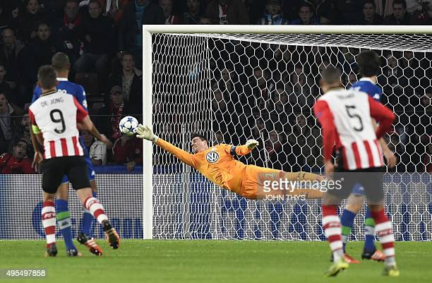 Wolfsburg's Swiss goalkeeper Diego Benaglio jumps to stop the ball during the UEFA Champions League football match PSV Eindhoven vs VfL wolfsburg at...