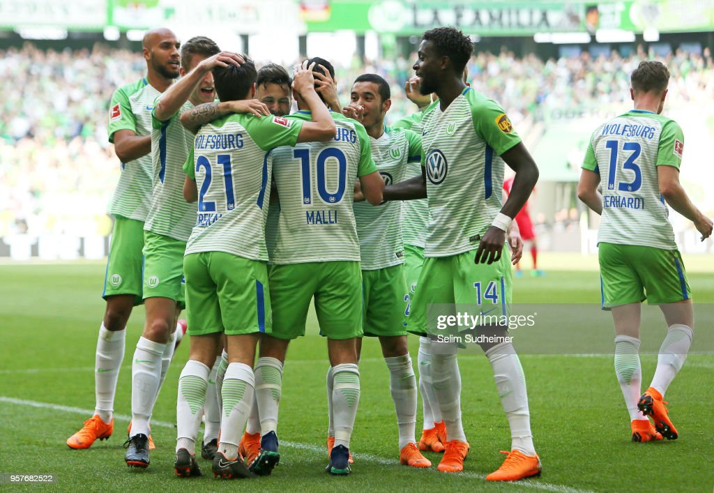 Wolfsburgs team celebrate their teams second goal scoring during the Bundesliga match between VfL Wolfsburg and 1. FC Koeln at Volkswagen Arena on May 12, 2018 in Wolfsburg, Germany.