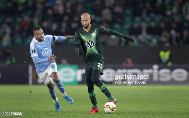 Wolfsburg's US defender John Anthony Brooks and Malmo's Swedish forward Isaac Kiese Thelin vie for the ball during the Europa League last 32 first...