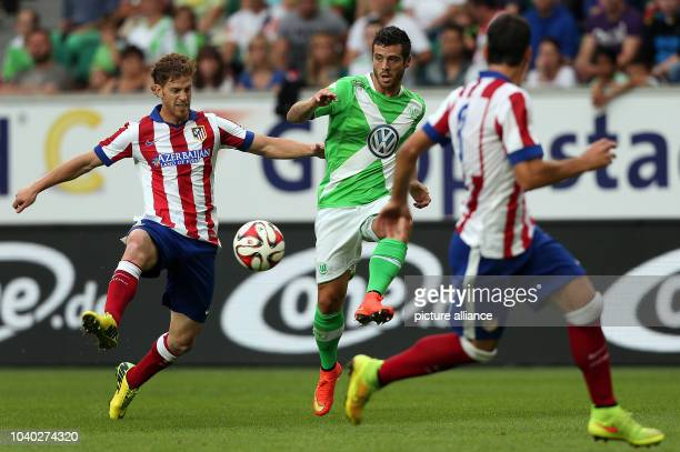 Wolfsburg's Vieirinha plays against Madrid's Cristian Ansaldi and Raul Garcia during the soccer test match VfL Wolfsburg vs Atletico Madrid at...
