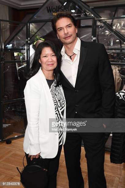 Wolfskin TECH LAB Melody HarrisJensbach and Marcus Schenkenberg attend the Wolfskin TECH LAB x Gianni Versace retrospective opening event at...