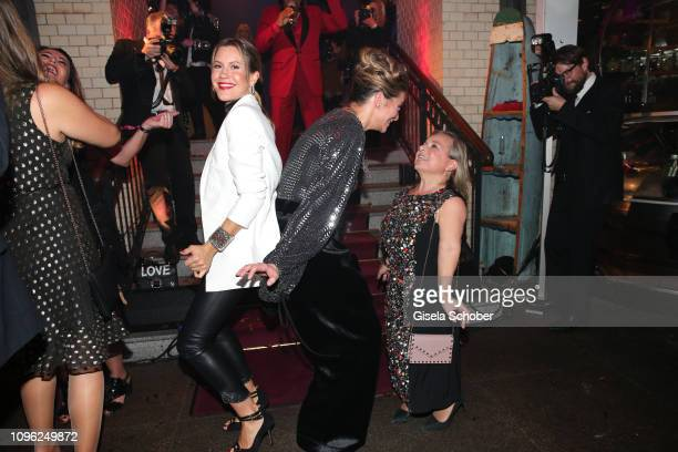 Wolke Hegenbarth Alexandra Kamp and ChrisTine Urspruch dance during the BUNTE BMW Festival Night at Restaurant Gendarmerie during the 69th Berlinale...