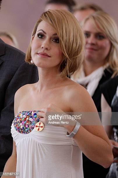 Wolke Hegenbarth looks on after she received from German President Christian Wulff the Federal Cross of Merit at Bellevue Castle on August 26, 2011...