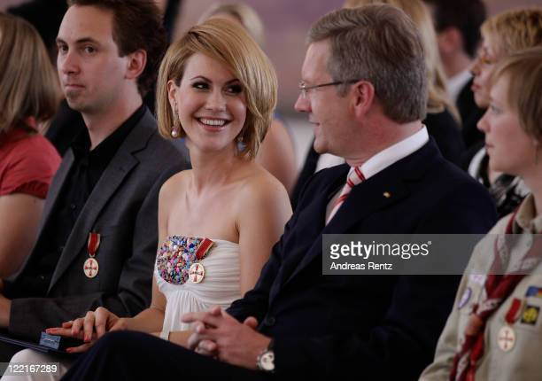 Wolke Hegenbarth smiles to German President Christian Wulff after she received the Federal Cross of Merit by Wulff at Bellevue Castle on August 26,...