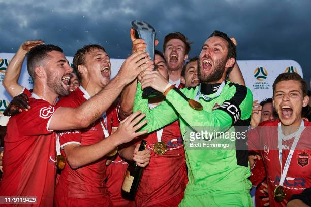 Wollongong players celebrate victory with the trophy during the National Premier Leagues Grand Final between Wollongong Wolves and Lions FC at Albert...