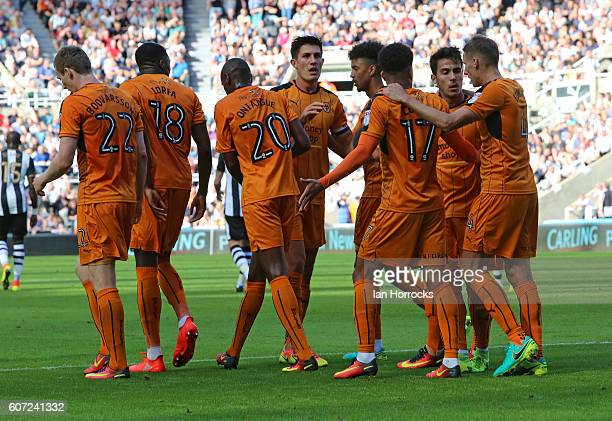 Wolverhampton players celebrate the opening goal during the Sky Bet Championship match between Newcastle United and Wolverhampton Wanders at St...