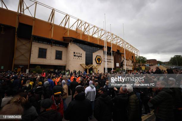 Wolverhampton Wanderer fans gather outside the stadium as they wait for the team bus to arrive ahead of the Premier League match between...