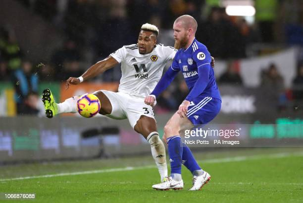 Wolverhampton Wanderers' Adama Traore and Cardiff City's Aron Gunnarsson battle for the ball during the Premier League match at Cardiff City Stadium