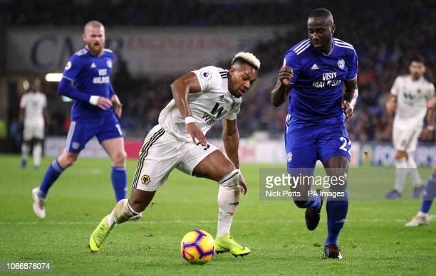Wolverhampton Wanderers' Adama Traore and Cardiff City's Sol Bamba battle for the ball during the Premier League match at Cardiff City Stadium