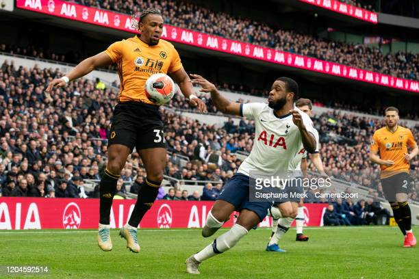 Wolverhampton Wanderers' Adama Traore battles for possession with Tottenham Hotspur's Japhet Tanganga during the Premier League match between...