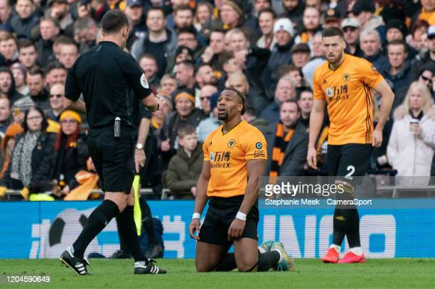 Wolverhampton Wanderers' Adama Traore questions referee Stuart Attwell during the Premier League match between Tottenham Hotspur and Wolverhampton...