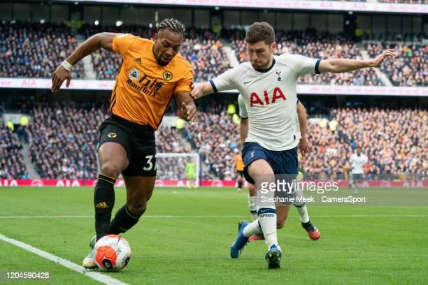Wolverhampton Wanderers' Adama Traore shields the ball from Tottenham Hotspur's Ben Davies during the Premier League match between Tottenham Hotspur...