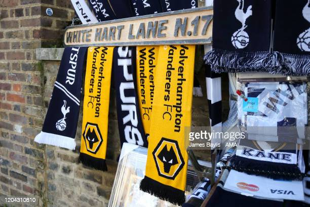 Wolverhampton Wanderers and Tottenham Hotspur half and half bar scarves for sale by a White Hart Lane sign outside the Tottenham Hotspur Stadium...