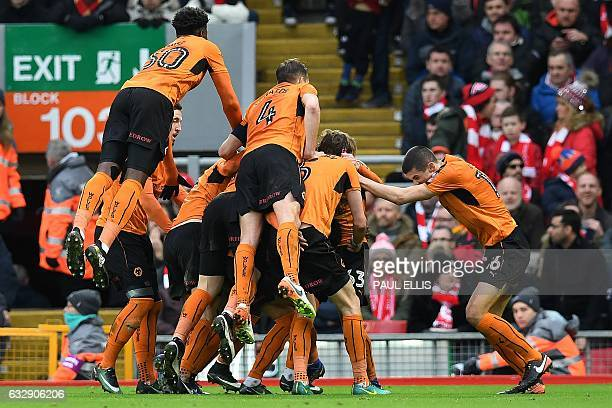 Wolverhampton Wanderers' Austrian striker Andreas Weimann is mobbed by teammates after he scored his team's second goal during the English FA Cup...