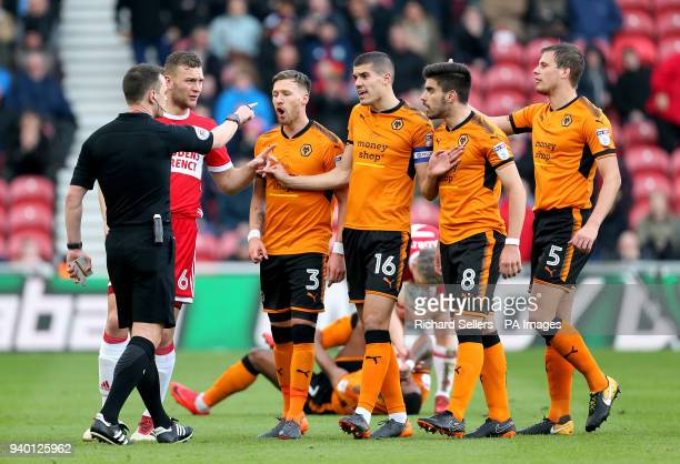 Wolverhampton Wanderers' Barry Douglas Conor Coady Ruben Neves and Ryan Bennett and Middlesbrough's Ben Gibson speak with match referee Stuart Atwell...