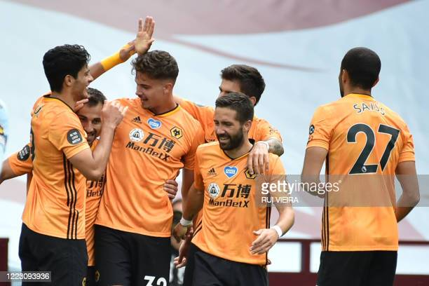 Wolverhampton Wanderers' Belgian midfielder Leander Dendoncker celebrates with teammates after he scores his team's first goal during the English...